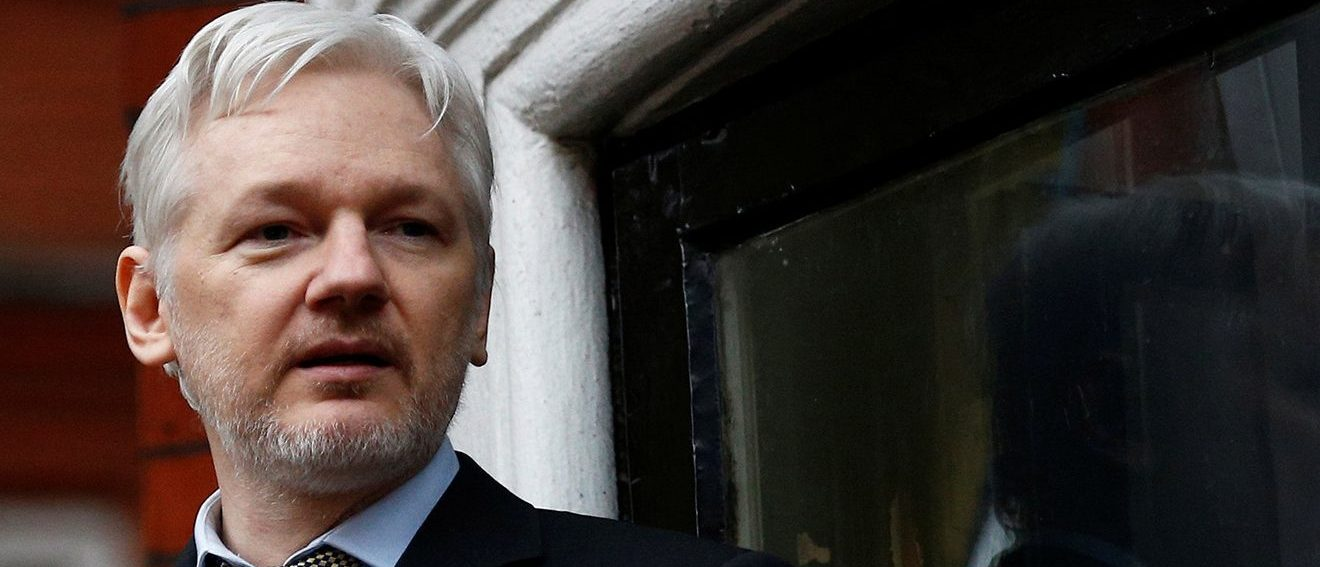 WikiLeaks founder Julian Assange makes a speech from the balcony of the Ecuadorian Embassy, in central London, Britain February 5, 2016. (PHOTO: REUTERS/Peter Nicholls/Files)