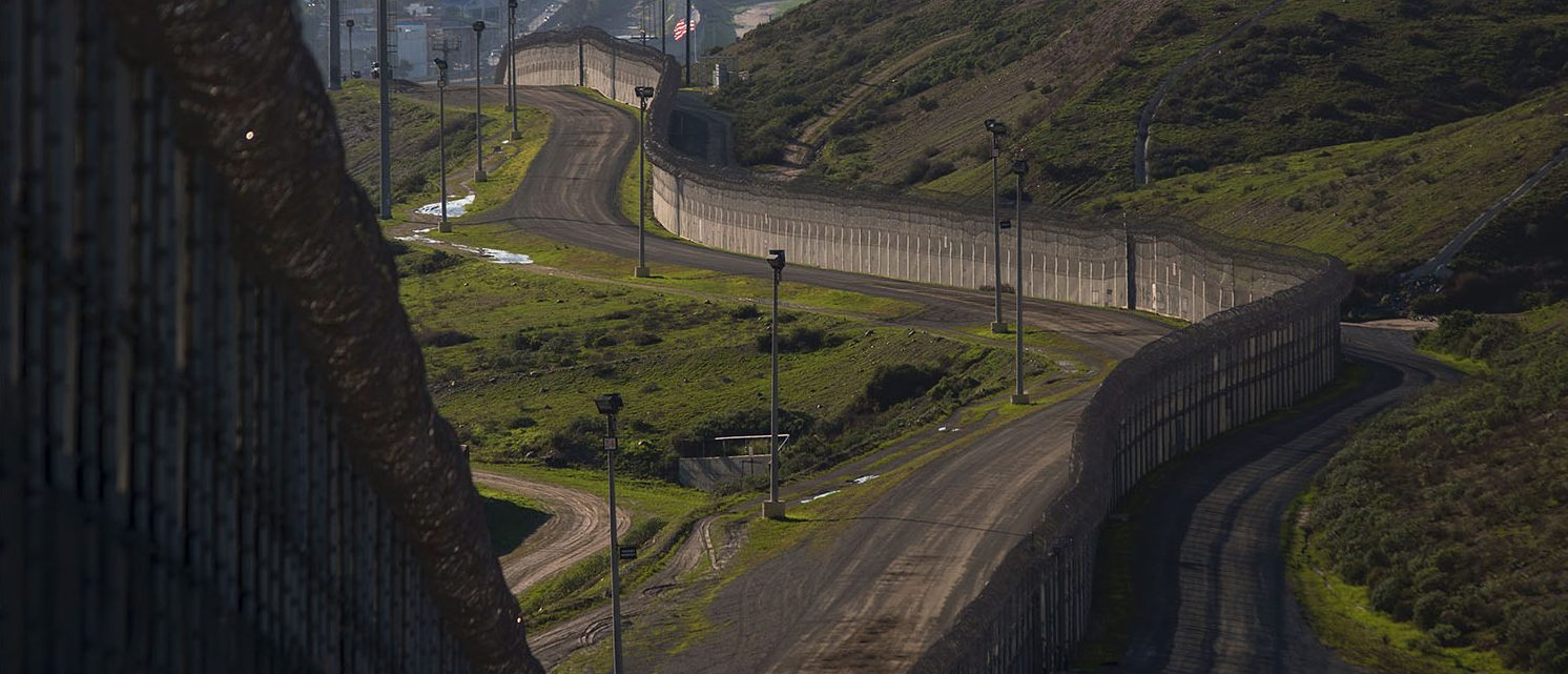 President Donald Trump has ordered work to begin on building a wall along the Mexican border, angering his southern neighbor with his hardline stance on immigration. (PHOTO: DAVID MCNEW/AFP/Getty Images)