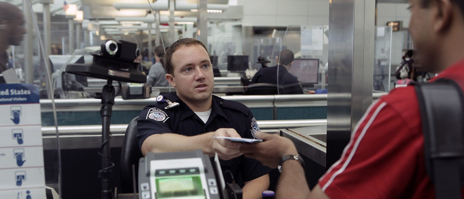 A CBP Officer processes an incoming passenger at the Newark International Airport. (PHOTO: James Tourtellotte/Customs and Border Protection/Govt photo)