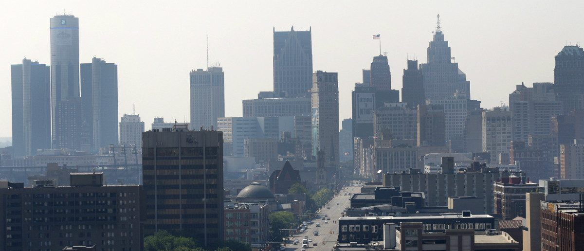 A view of the Detroit skyline is seen looking south up Woodward Avenue in Detroit, Michigan July 19, 2013. REUTERS/ Rebecca Cook