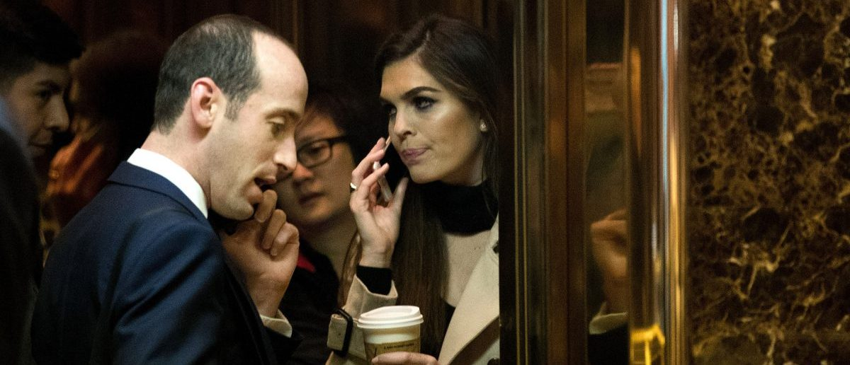Stephen Miller, policy advisor with the Trump transition team, and Hope Hicks, communications director with the Trump campaign, arrive at Trump Tower, December 1, 2016 in New York City. (Drew Angerer/Getty Images)