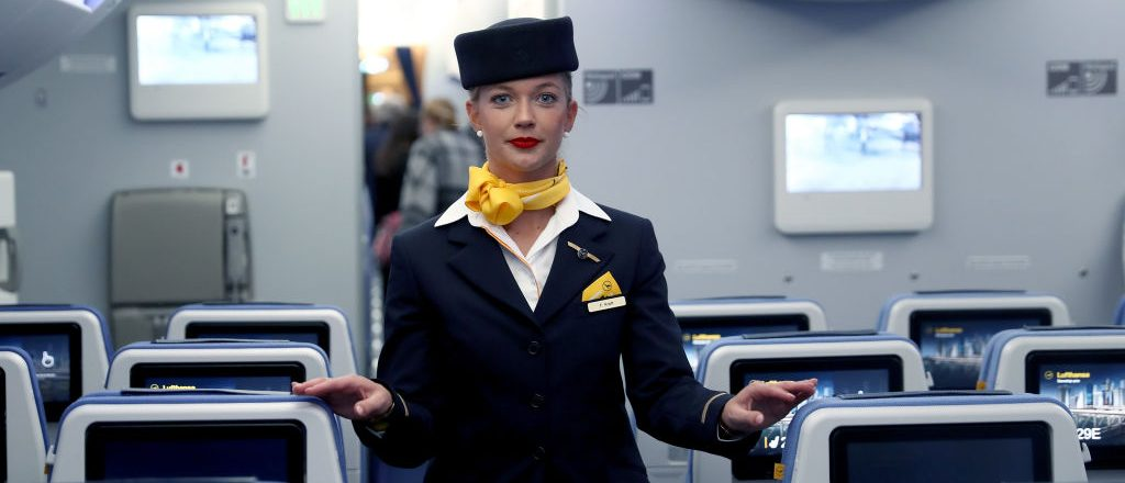 MUNICH, GERMANY - FEBRUARY 02: A airhostess of German airline Lufthansa, stands in cabine at the passenger deck of the company's first Airbus A350-900 passenger plane during a roll-out event at Munich Airport on February 2, 2017 in Munich, Germany. The Airbus A350 series of planes is the latest generation of passenger planes the company offers. (Photo by Alexander Hassenstein/Getty Images)