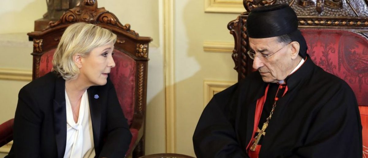 France's far-right presidential candidate Marine Le Pen (L) meets with Lebanon's Cardinal Mar Bechara Boutros al-Rai (R), the Maronite Patriarch of Antioch and the Whole Levant, at the Maronite Patriarchate in Bekerke north of Beirut on February 21, 2017. [Photo: JOSEPH EID/AFP/Getty Images]