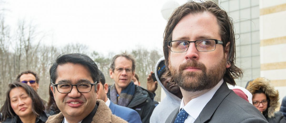 Attorneys for the ACLU, Omar Jadwat(L) and Justin Cox(R) deliver remarks to the media outside US District Court, Southern District of Maryland, March 15, 2017, in Greenbelt, Maryland, where judges heard their challenges to US President Trump's Executive Order travel ban. / AFP PHOTO / PAUL J. RICHARDS (Photo credit should read PAUL J. RICHARDS/AFP/Getty Images)