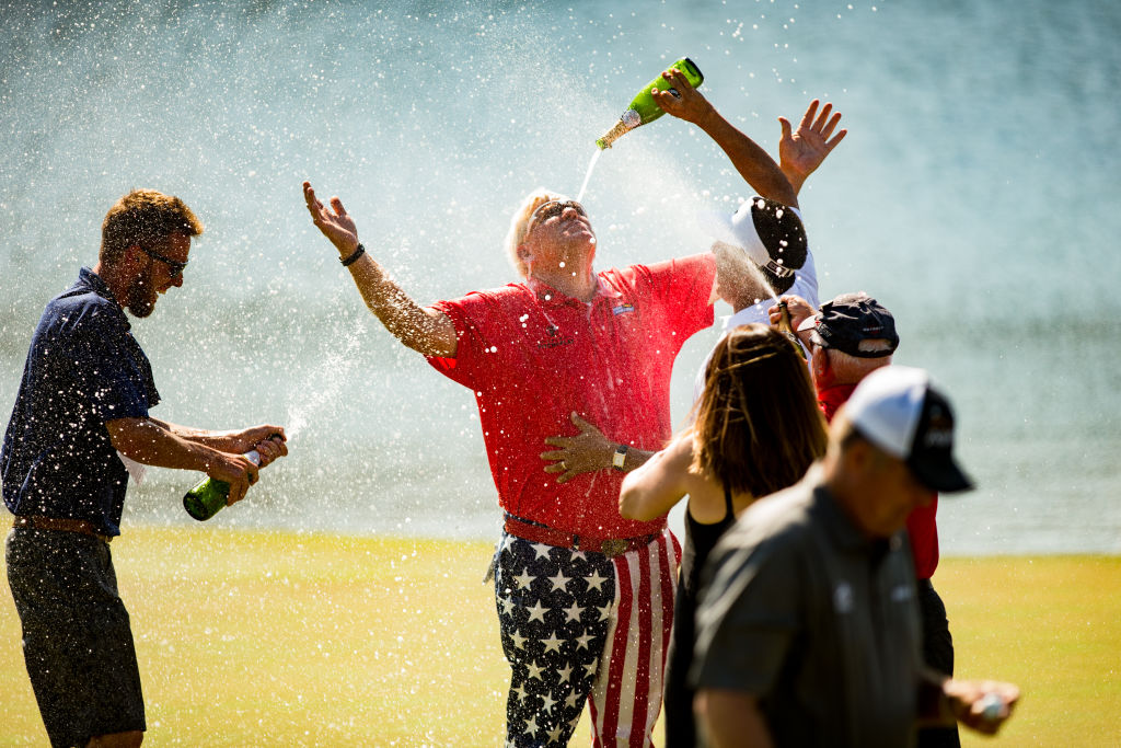 John Daly of the United States is sprayed with champagne at the eighteenth green following his victory at the PGA TOUR Champions Insperity Invitational at The Woodlands Country Club on May 7, 2017 in The Woodlands, Texas. (Photo by Darren Carroll/Getty Images)