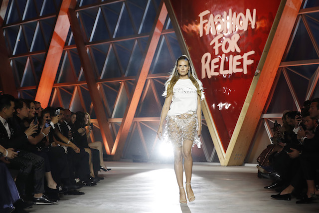 CANNES, FRANCE - MAY 21: Heidi Klum walks the runway at the Fashion for Relief event during the 70th annual Cannes Film Festival at Aeroport Cannes Mandelieu on May 21, 2017 in Cannes, France. (Photo by Tristan Fewings/Getty Images)