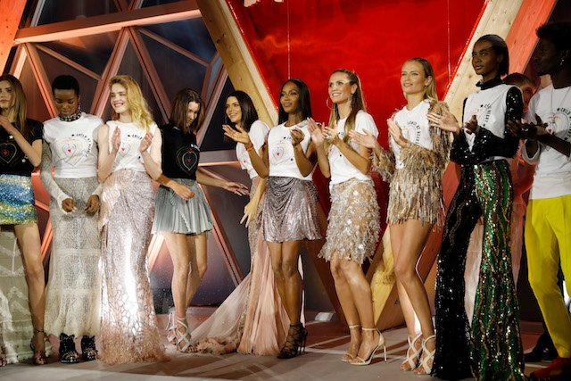 CANNES, FRANCE - MAY 21: (L-R) Valery Kaufman, Maria Borges,Natalia Vodianova,Bella Hadid,Naomi Campbell,Heidi Klum,Natasha Poly and Tami Williams pose on the runway at the Fashion for Relief event during the 70th annual Cannes Film Festival at Aeroport Cannes Mandelieu on May 21, 2017 in Cannes, France. (Photo by Tristan Fewings/Getty Images)