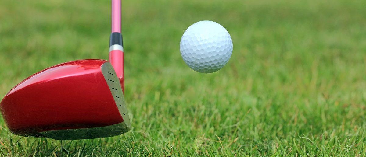 Driving Golf Ball off the Fairway on a Golf Course. (Dean Clarke/Shutterstock)