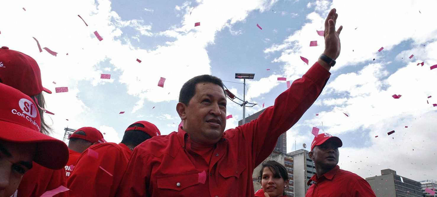 Venezuelan President Hugo Chavez waves to supporters during a rally for the constitutional amendments promoted by him 04 November, 2007 in Caracas. (PHOTO: AFP/Getty Images/Enrique HERNANDEZ )