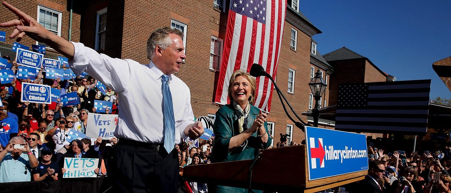 Democratic presidential candidate Hillary Clinton (C) is introduced by Virginia Governor Terry McAuliffe (L) as she takes the stage for a rally with grassroots supporters in Alexandria, Virginia, October 23, 2015. (PHOTO: REUTERS/Jonathan Ernst)