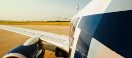 FRANKFURT, GERMANY - JUL 3, 2015: Hot day over International airport with modern aircraft wing and fuselage part landing taking off from modern airport (Hadrian/Shutterstock)