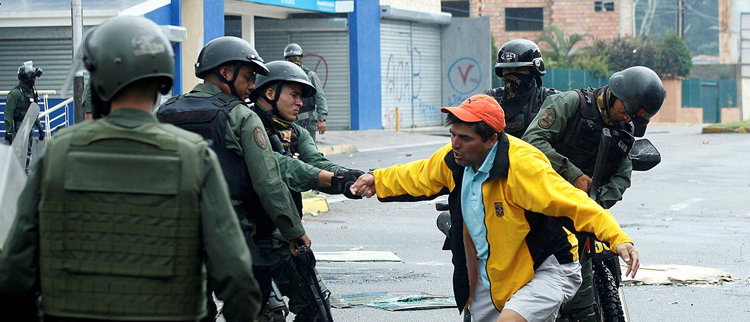 A demonstrator is detained by riot security forces during a protest against Venezuelan President Nicolas Maduro's government in San Cristobal, Venezuela May 29, 2017. (PHOTO: REUTERS/Carlos Eduardo Ramirez)