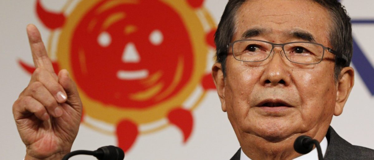 """Former Tokyo Governor Shintaro Ishihara speaks in front of the logo of his new party named """"Sunrise Party"""" during a news conference in Tokyo November 13, 2012. Ishihara launched the new party on Tuesday, jointly headed by himself and veteran lawmaker Takeo Hiranuma, in the run-up to a general election. REUTERS/Yuriko Nakao"""