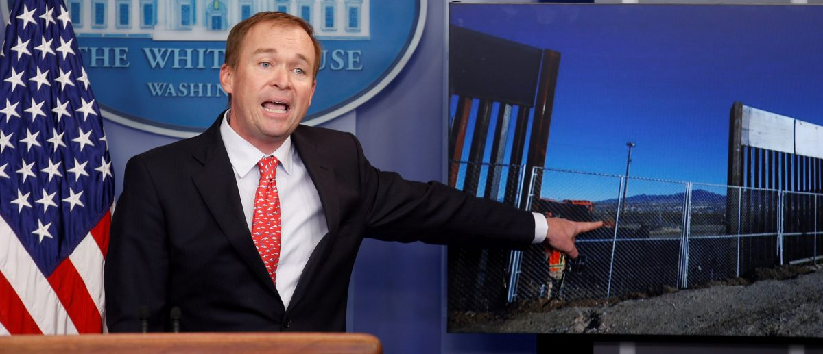 Director of the Office of Management and Budget Mick Mulvaney points to a picture of construction of the southern border while speaking about the budget agreement reached by Congress during a press briefing at the White House in Washington, U.S., May 2, 2017. (PHOTO: REUTERS/Joshua Roberts)