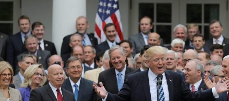 U.S. President Donald Trump (C) gathers with Congressional Republicans in the Rose Garden of the White House after the House of Representatives approved the American Healthcare Act, to repeal major parts of Obamacare and replace it with the Republican healthcare plan, in Washington, U.S., May 4, 2017. (Reuters/Carlos Barria)