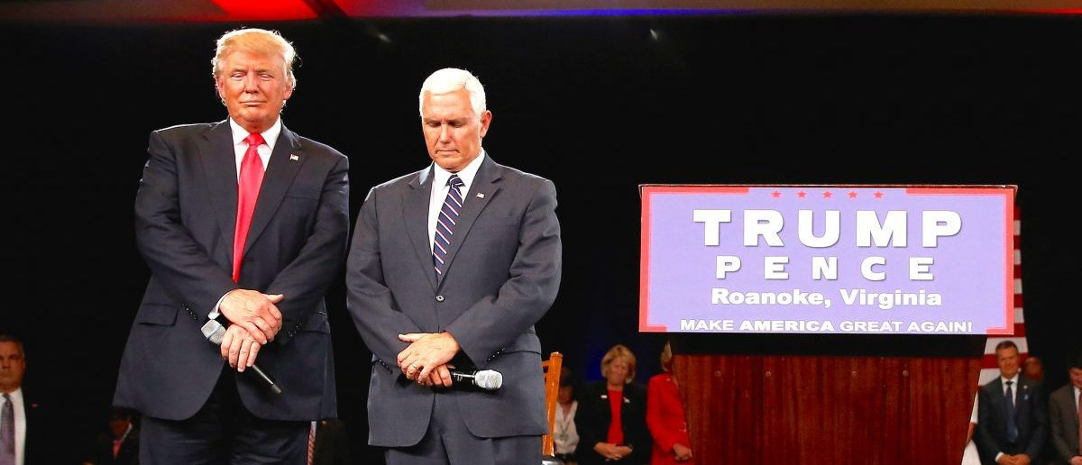 Donald Trump and Mike Pence pray at a campaign event in Roanoke, Virginia, U.S., July 25, 2016. (REUTERS/Carlo Allegri)
