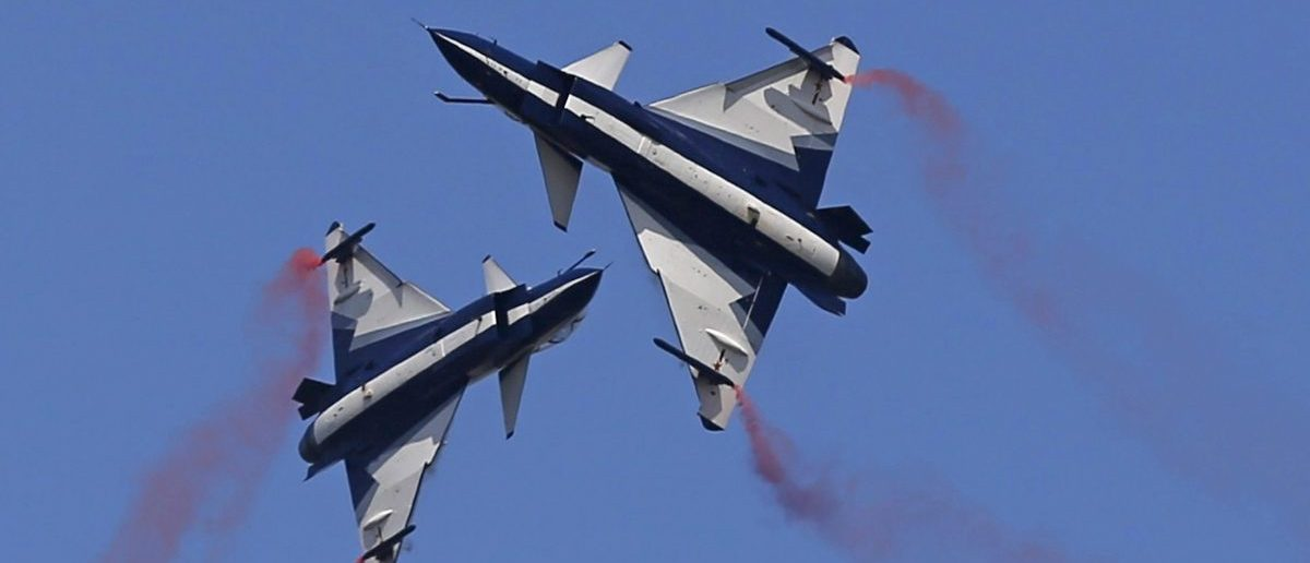 China's J-10 fighter jets from the People's Liberation Army Air Force August 1st Aerobatics Team perform during a media demonstration at the Korat Royal Thai Air Force Base, Nakhon Ratchasima province, Thailand, November 24, 2015. Thailand's military held an air show with China on Tuesday ahead of joint manoeuvres in a sign of warming ties, but Thailand said it was not distancing itself from the United States which downgraded the military relationship following a 2014 coup. REUTERS/Athit Perawongmetha