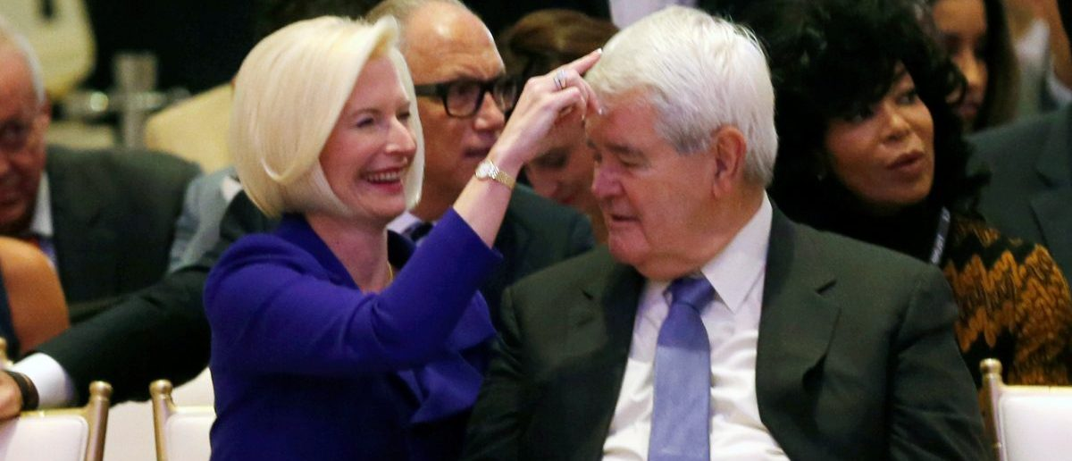 Callista Gingrich (L) fixes the hair of her husband Newt Gingrich at an official ribbon cutting ceremony and opening news conference at the new Trump International Hotel in Washington U.S., October 26, 2016. (Photo: REUTERS/Gary Cameron)