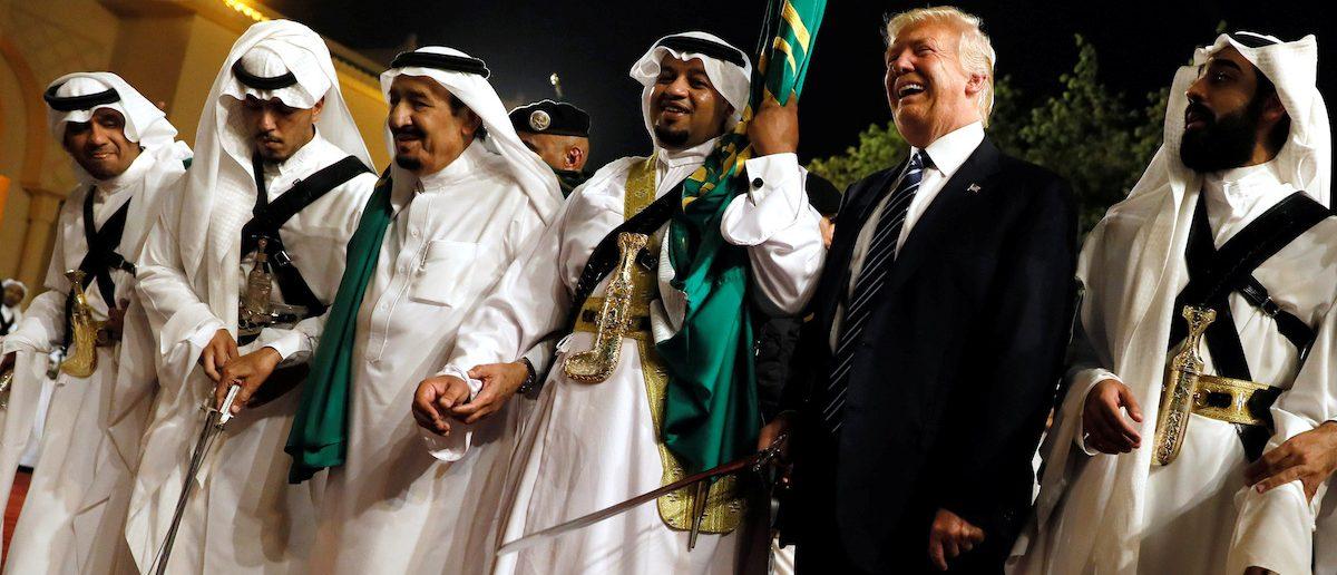 U.S. President Donald Trump dances with a sword as he arrives to a welcome ceremony by Saudi Arabia's King Salman bin Abdulaziz Al Saud at Al Murabba Palace in Riyadh, Saudi Arabia May 20, 2017. REUTERS/Jonathan Ernst TPX IMAGES OF THE DAY - RTX36R4D
