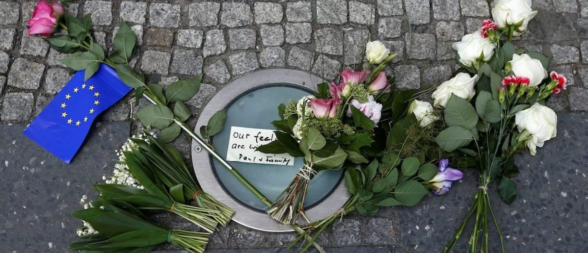 Flowers as a tribute for victims of Monday's suicide bombing at Manchester Arena in the English city of Manchester are seen in front of the British embassy in Berlin, Germany May 23, 2017. REUTERS/Fabrizio Bensch - RTX376XA