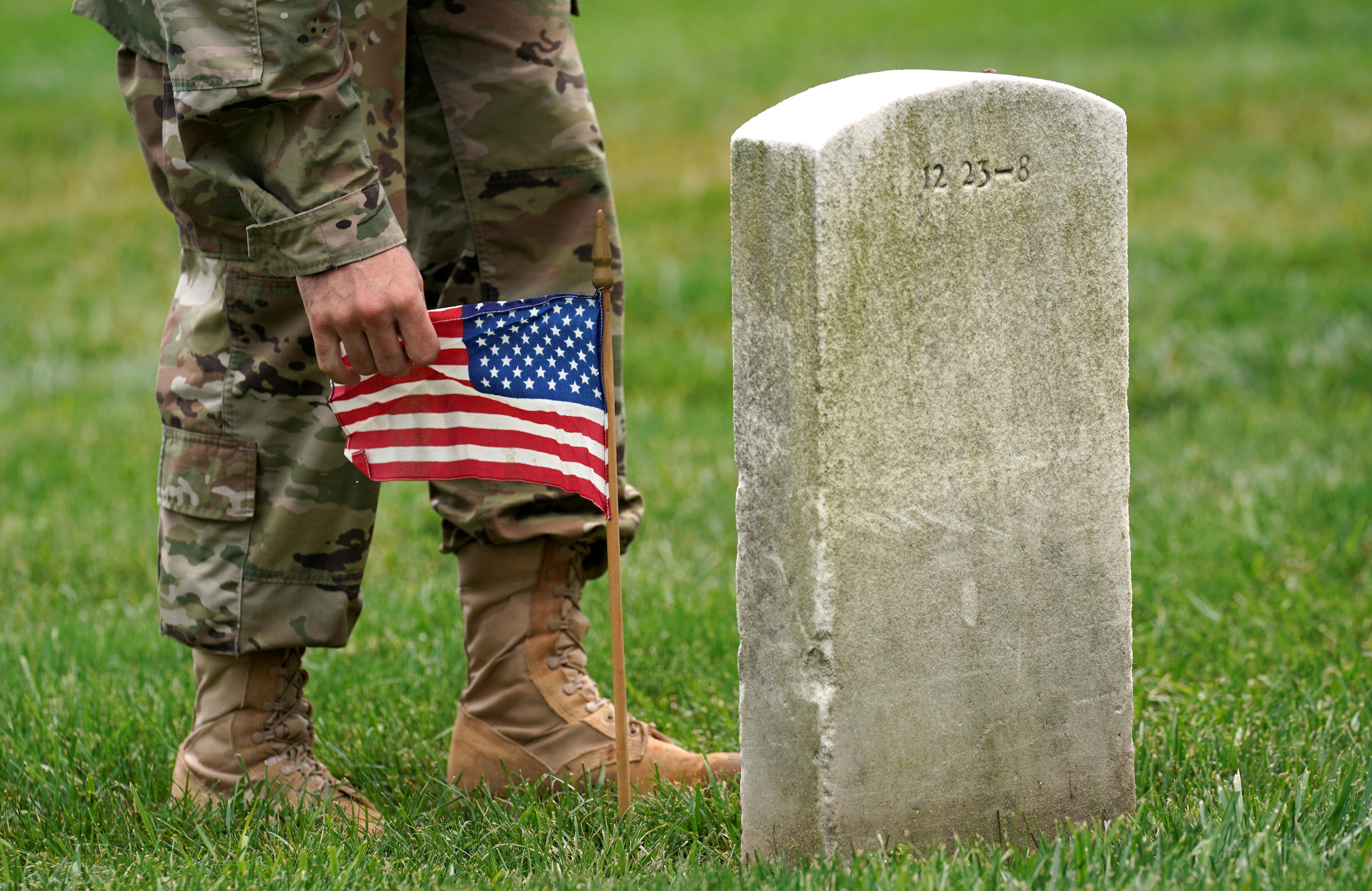 A Soldier From The 3rd U S Infantry Regiment Old Guard Takes Part In Flags In Where A Flag Is Placed At Each Of The 284 000 Headstones At Arlington