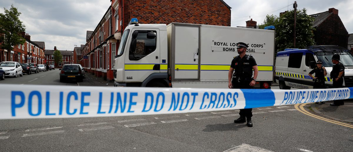 A bomb disposal unit and police officers wait behind cordon outside an address in Moss Side, Manchester, Britain May 27, 2017. REUTERS/Phil Noble TPX IMAGES OF THE DAY - RTX37UOJ