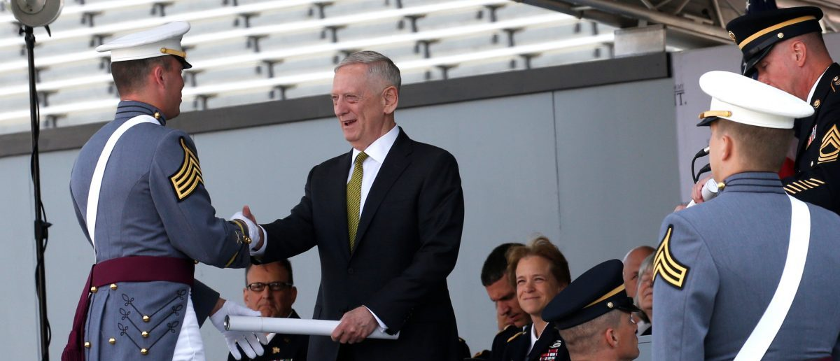 U.S. Secretary of Defense James Mattis presents a diploma to Class President Mario Andrew Contreras Jr. (L) during commencement ceremonies at the United States Military Academy in West Point, New York, U.S., May 27, 2017. REUTERS/Mike Segar
