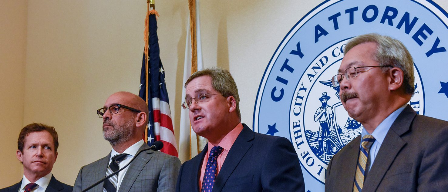 REFILE - ADDITIONAL INFORMATION San Francisco City Attorney Dennis Herrera, third from left, with Jesse Smith, Chief Assistant City Attorney, Ron Flynn, Chief Deputy City Attorney and Mayor Ed Lee, announces he has filed a lawsuit against President Donald Trump for his unconstitutional executive order targeting sanctuary cities during a news conference at city Hall in San Francisco, California, U.S., January 31, 2017. (PHOTO: REUTERS/Kate Munsch)