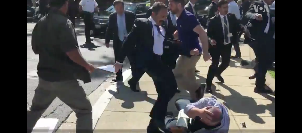 Turkish Security Guard kicks protestor Screenshot/Youtube