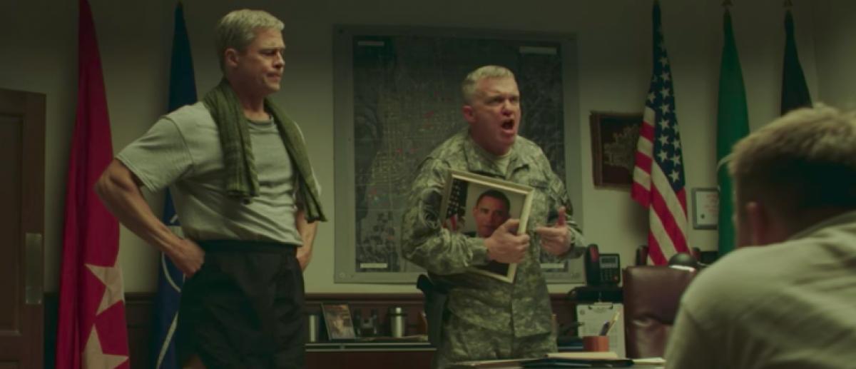 "Brad Pitt and Michael W. Hall in ""War Machine."" (Image: YouTube screengrab/Netflix)"