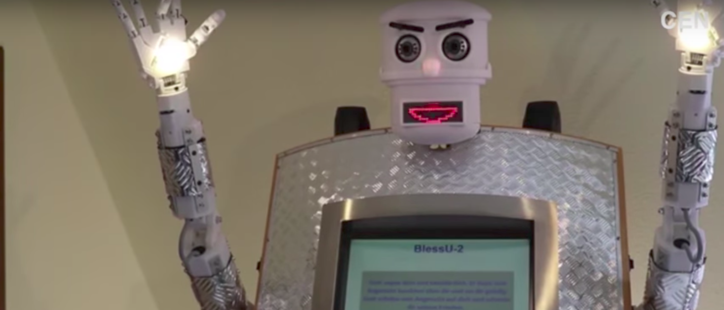 The BlessU-2 Robot shines light from its hands and dispenses Christian blessings (Photo: Daily Mail Online YT/Youtube Screengrab)
