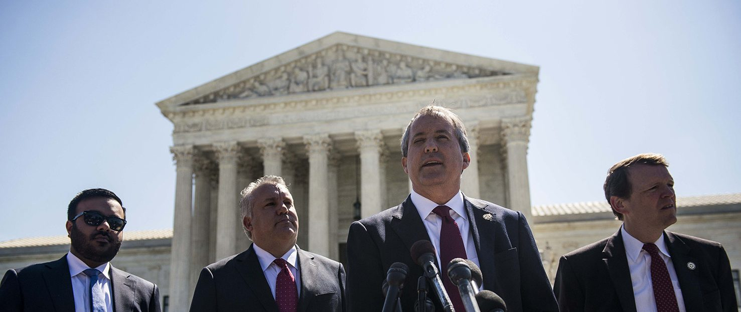 Texas Attorney General Ken Paxton speaks to reporters at a news conference outside the Supreme Court on Capitol Hill on June 9, 2016 in Washington, D.C. Paxton announced a lawsuit against the state of Delaware over unclaimed checks.  (PHOTO: Gabriella Demczuk/Getty Images)