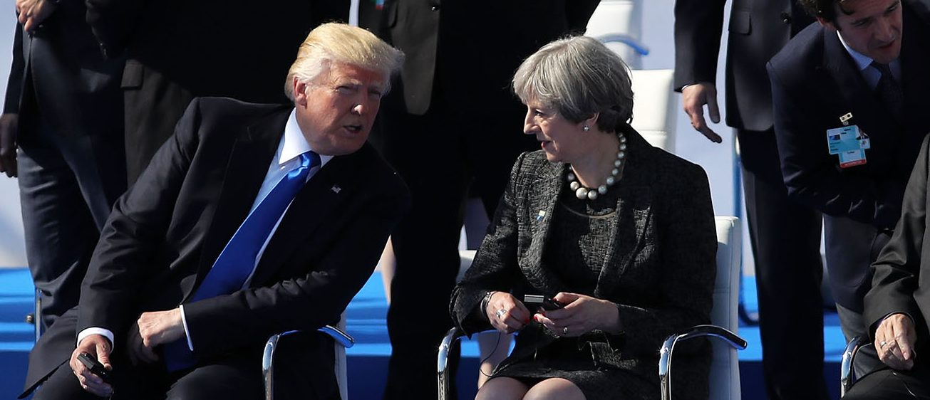 US President, Donald Trump and British Prime Minister, Theresa May chat ahead of a photo opportunity of world leaders arriving for a NATO summit meeting on May 25, 2017 in Brussels, Belgium. The North Atlantic Treaty Organisation (NATO) is made up of 28 countries. This year's summit is held at their new headquarters in Brussels. The US President Donald Trump will meet other leaders to discuss NATO taking a greater role in the fight against ISIS. (PHOTO: Dan Kitwood - WPA Pool /Getty Images)