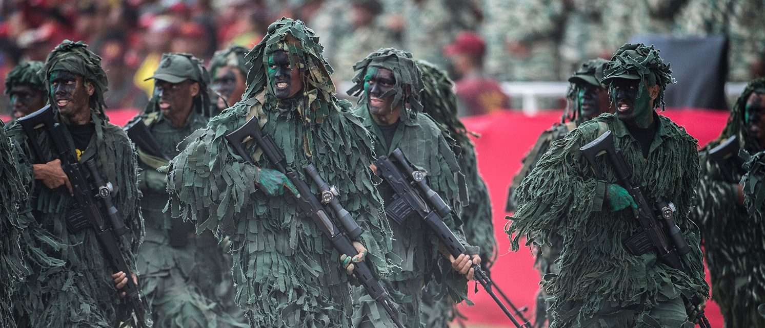 Venezuelan army snipers run in a military parade in Caracas on February 1, 2017. (PHOTO: AFP/Getty Images/JUAN BARRETO)