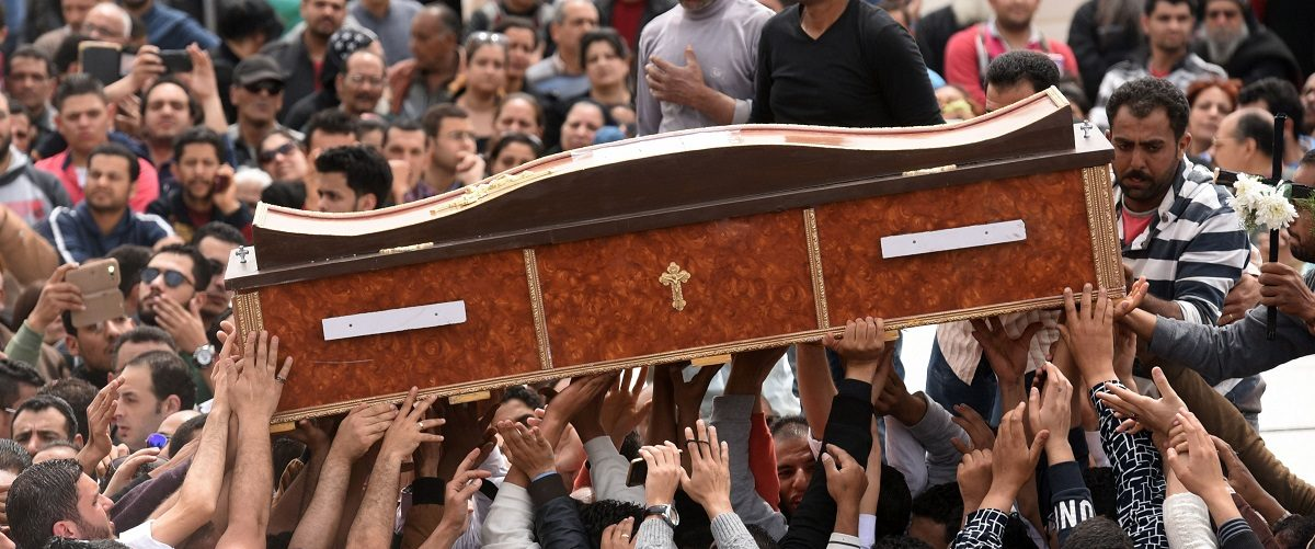 Mourners carry the coffin of one of the victims of the blast at the Coptic Christian Saint Mark's church in Alexandria the previous day during a funeral procession at the Monastery of Marmina in the city of Borg El-Arab, east of Alexandria on April 10, 2017. Egypt prepared to impose a state of emergency after jihadist bombings killed dozens at two churches in the deadliest attacks in recent memory on the country's Coptic Christian minority. Mohamed El-Shahed/AFP/Getty Images.