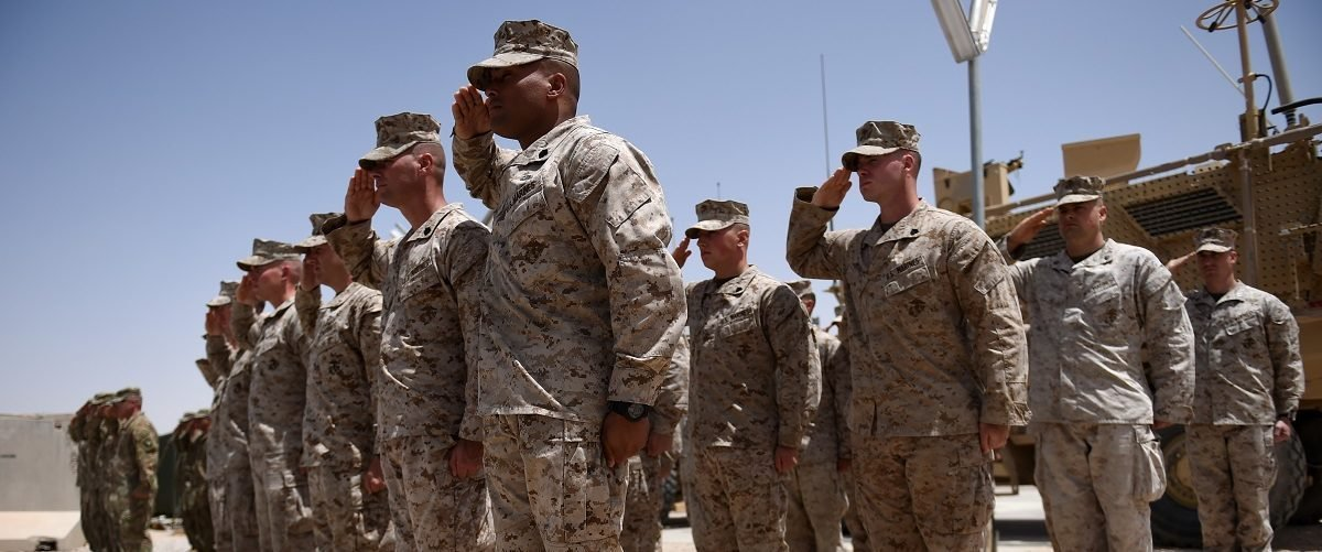 "US Marines salute during a handover ceremony at Leatherneck Camp in Lashkar Gah in the Afghan province of Helmand on April 29, 2017.  US Marines returned to Afghanistan's volatile Helmand April 29, where American troops faced heated fighting until NATO's combat mission ended in 2014, as embattled Afghan security forces struggle to beat back the resurgent Taliban. The deployment of some 300 Marines to the poppy-growing southern province came one day after the militants announced the launch of their ""spring offensive"", and as the Trump administration seeks to craft a new strategy in Afghanistan. Wakil Kohsar/AFP/Getty Images."