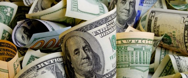 Piles of cash. Rrraum/Shutterstock | FBI Specialist Stole $160k In Funds