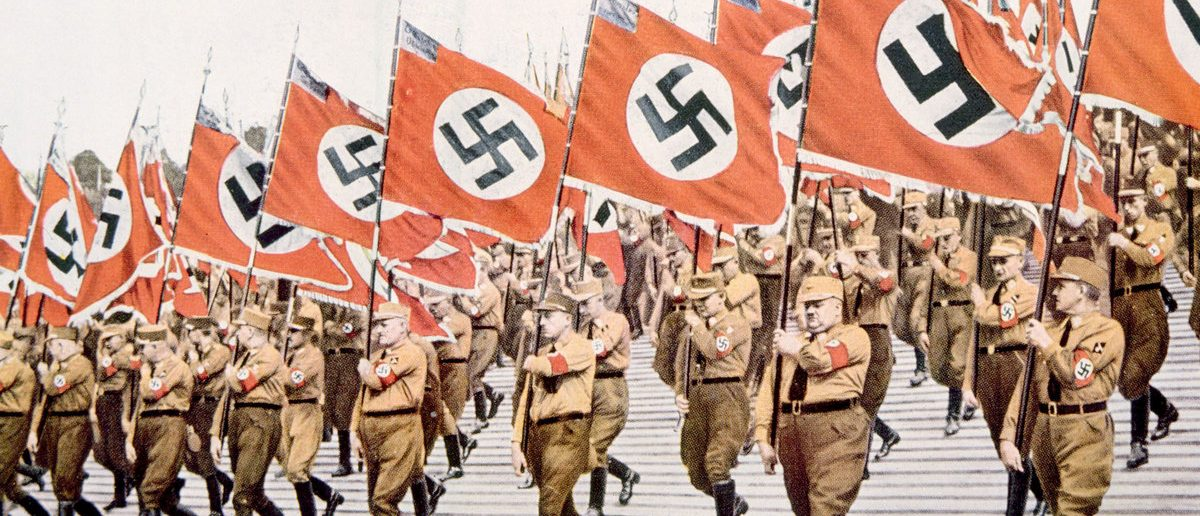 Nazi Germany, Entrance of the Nazi flagbearers at the Party Day rally in Nuremberg, 1933. (Shutterstock/Everett Historical)
