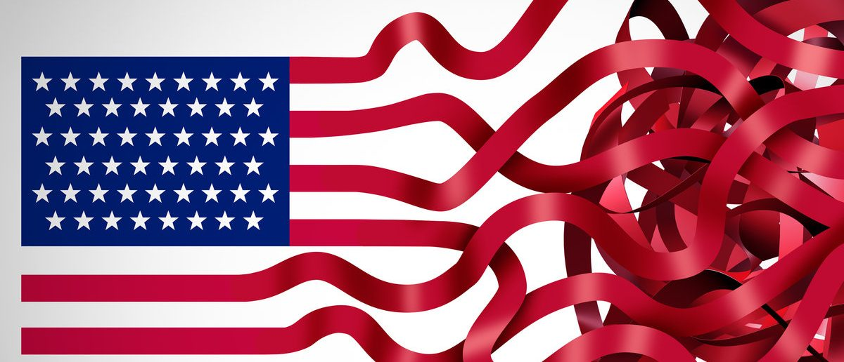 Government red tape concept and American bureaucracy symbol as an icon of the flag of the United States with the red stripes getting tangled in confusion as a metaphor for political inefficiency. (Shutterstock/ Lightspring)