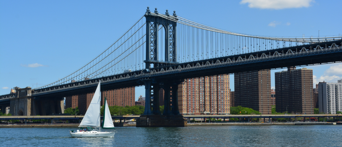Sailboat on the East River passing under the Manhattan Bridge. (Photo: Shutterstock/Christopher Penler)