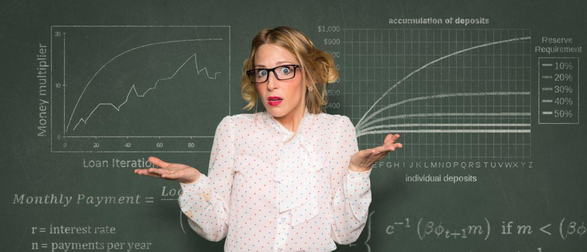 Confused teacher at blackboard (Shutterstock/El Nariz)