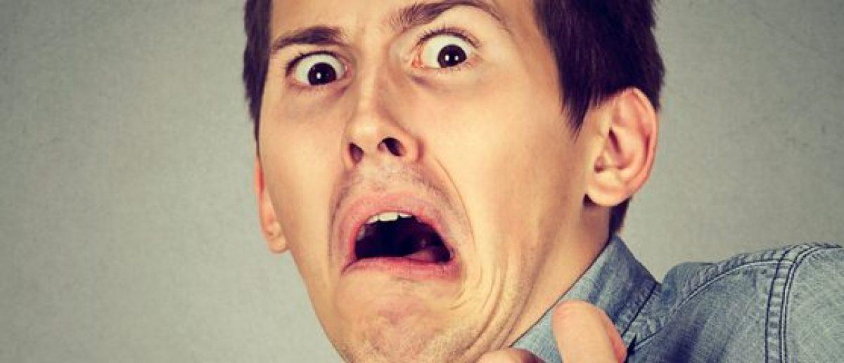 Man screams in fear (Shutterstock/pathdoc)