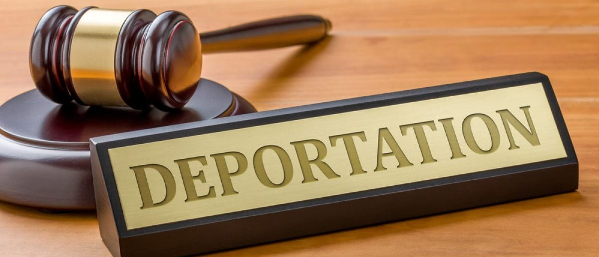 "A gavel and a ""Deportation"" name plate. [Shutterstock - Zerbor]"