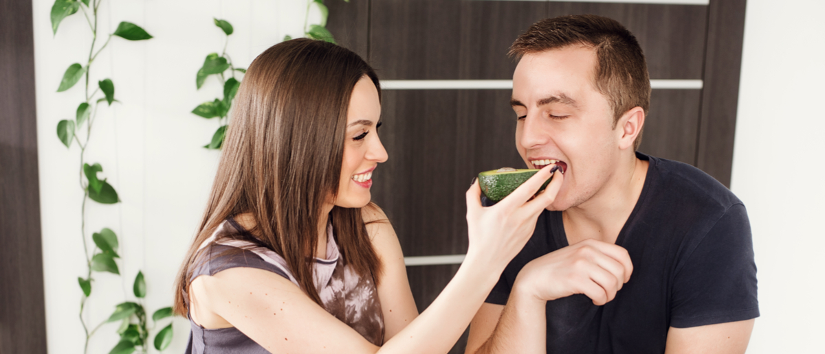 Couple eats avocados (Photo: Shutterstock/Liliia Mykhalevych)
