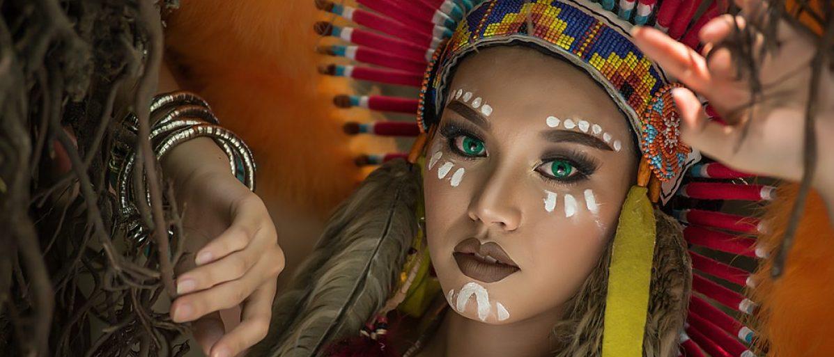 Girl in a Native American headdress (Shutterstock/Tanakorn Pussawong)
