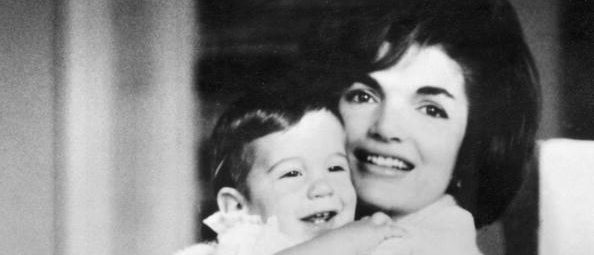 Jacqueline Kennedy, wife of US president hold her son, John jr, in her arms. John-John was born on 25 November 1960. (Photo credit should read -/AFP/Getty Images)