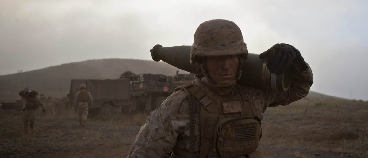 U.S. Marine Lance Cpl. Michael Farris, an Artillery Cannoneer assigned to 1st Battalion, 12th Marine Regiment, Alpha Battery, carries a round back to his gun to resupply before a fire mission aboard Pohakuloa Training Are, Hawaii, Sept. 5, 2014. Members of 1st Battalion, 12th Marines are enhancing their skills of direct fire support in support of operation Spartan Fury.