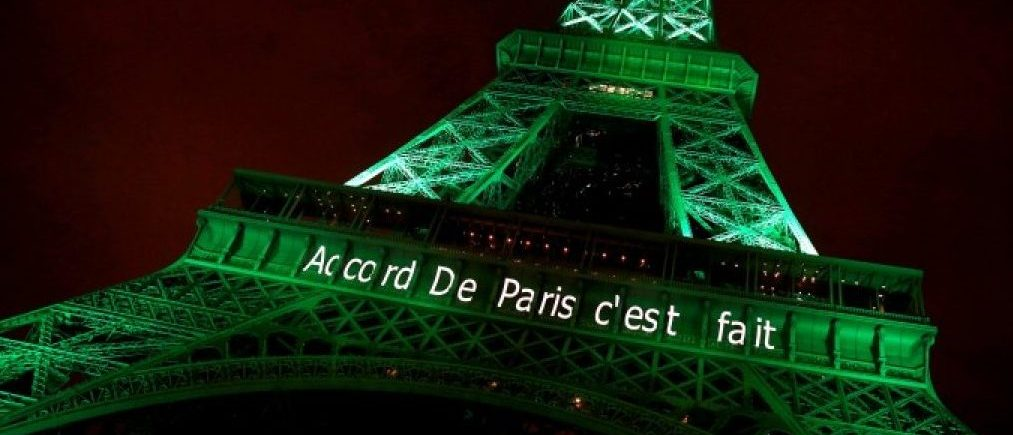 "FILE PHOTO: The Eiffel tower is illuminated in green with the words ""Paris Agreement is Done"", to celebrate the Paris U.N. COP21 Climate Change agreement in Paris, France, November 4, 2016. REUTERS/Jacky"