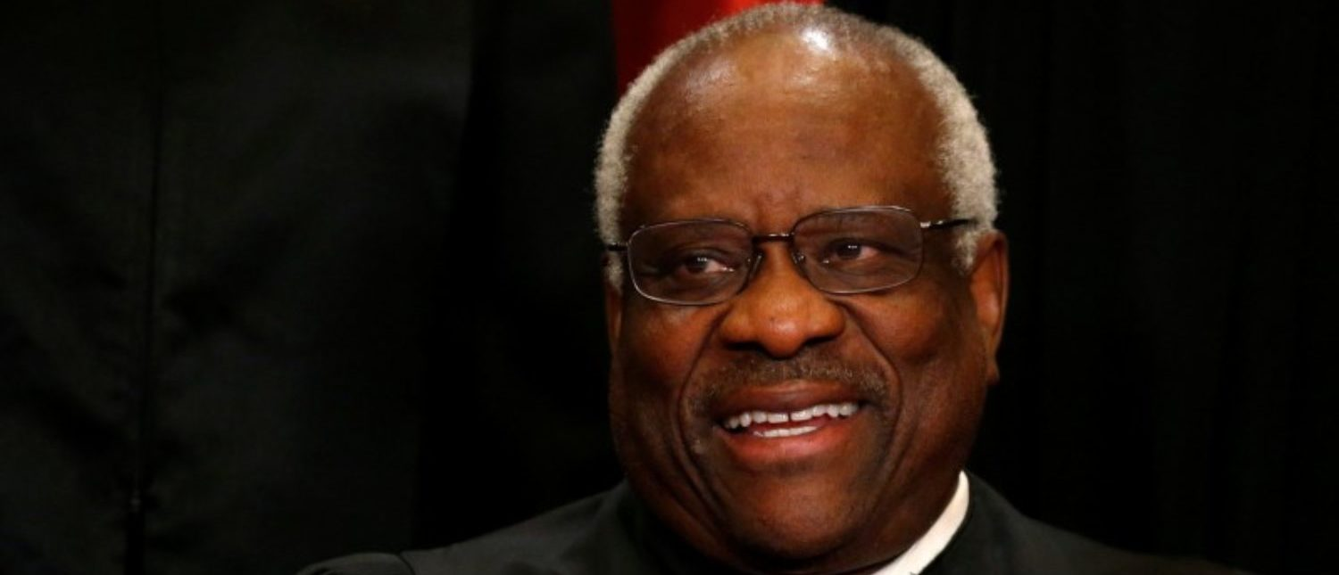 U.S. Supreme Court Justice Clarence Thomas participates in taking a new family photo with her fellow justices at the Supreme Court building in Washington, D.C., U.S., June 1, 2017. REUTERS/Jonathan Ernst