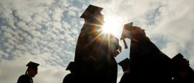 Graduating students arrive for Commencement Exercises at Boston College in Boston, Massachusetts, U.S. on May 20, 2013. REUTERS/Brian Snyder